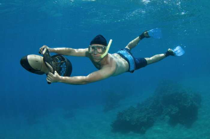 snorkeler on an underwater scooter